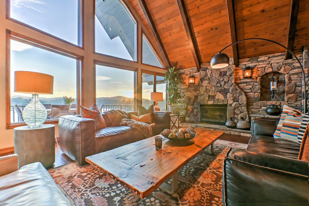 As you step inside, enjoy the natural sunlight the home's high wall of windows offer in the main living area.