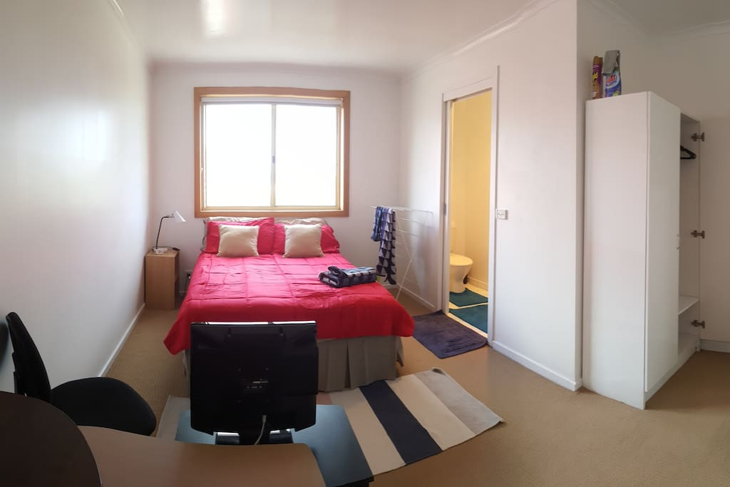 double bed with en-suite, television, cabinet