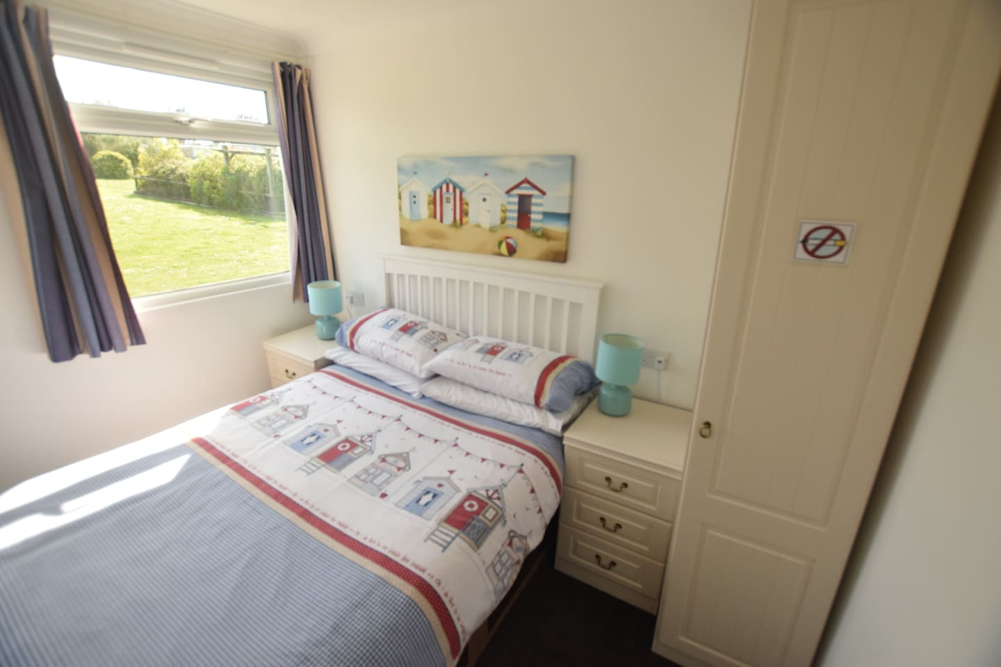The double bedroom in our holiday chalet has a double bed with bedside drawers and a wardrobe