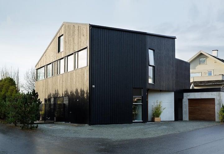 Arkitekttegnet Villa for flere familier i Sandnes.
