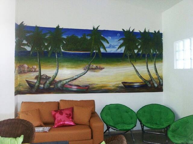 Hand painted mural in living area with additional couch/bed