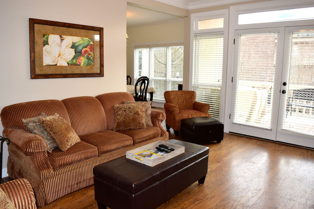 The comfortable living room seats 8 and has an HD TV and a pullout sofa.