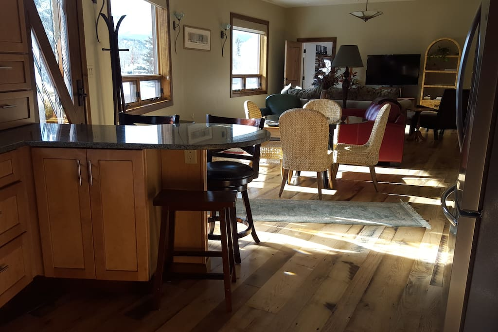 View from kitchen to dining area and open living room
