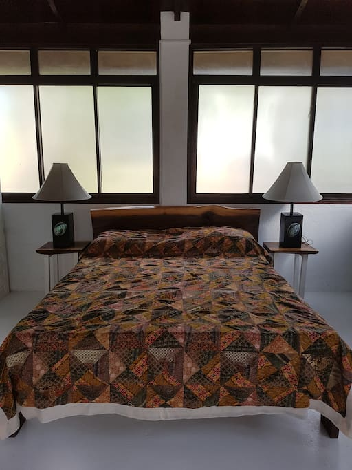 Queen size bed in an air-conditioned room