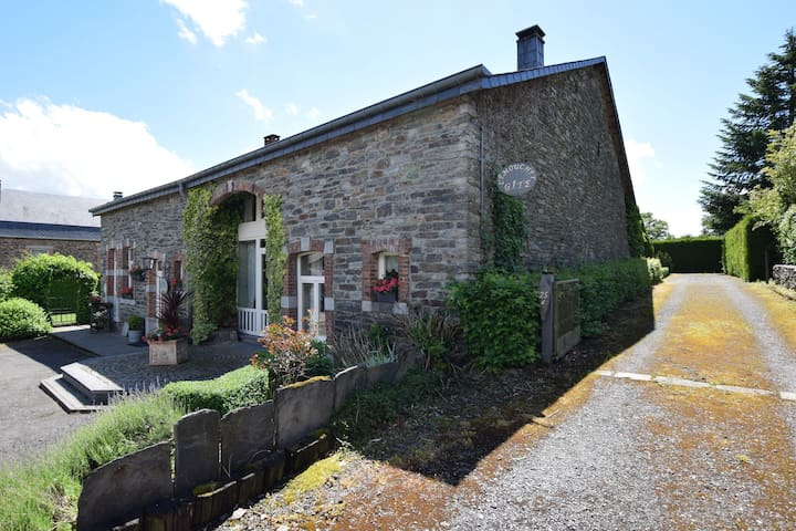 An old farmhouse in a peaceful Ardennes village on the edge of the forest
