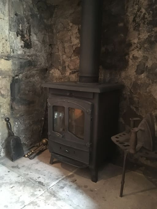 Real log burner in 17th century original fire place - in lounger/dining room area (fire lighters & initial log supply provided)