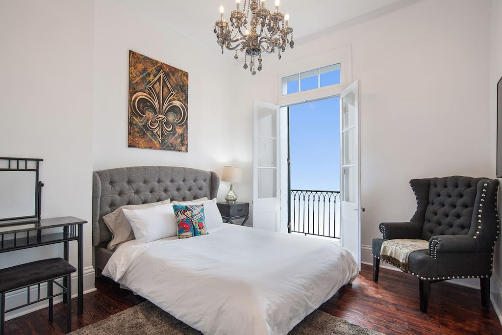 Comfortable bed, chandelier and New Orleans charm