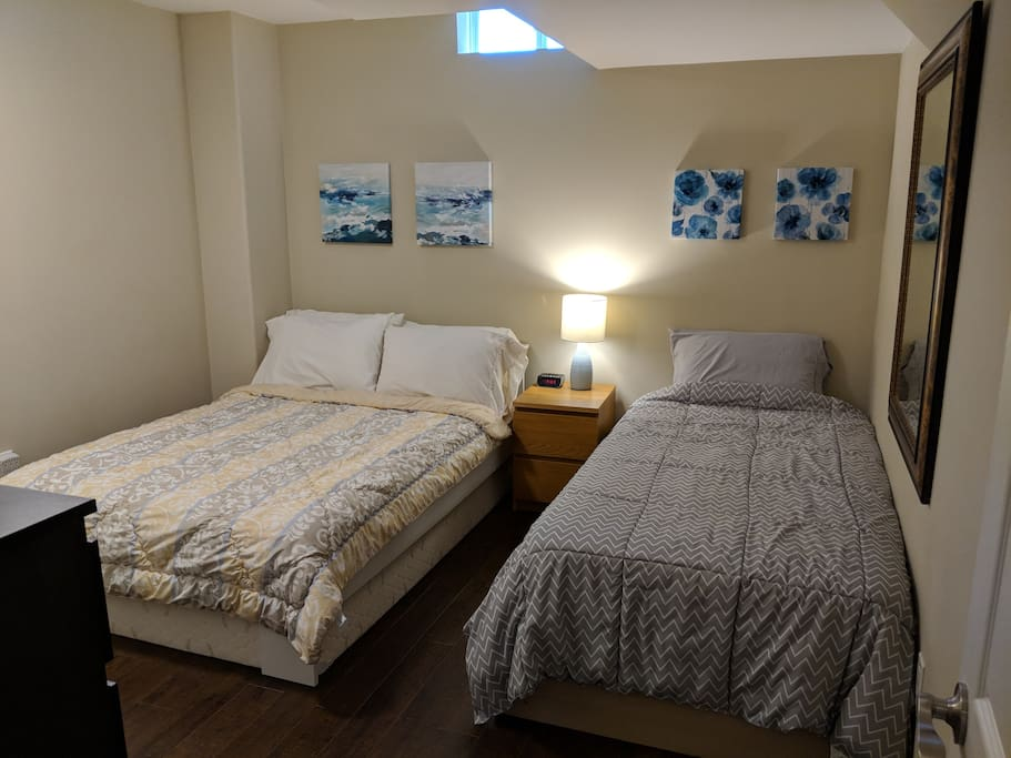 Bedroom with one double bed and one single bed
