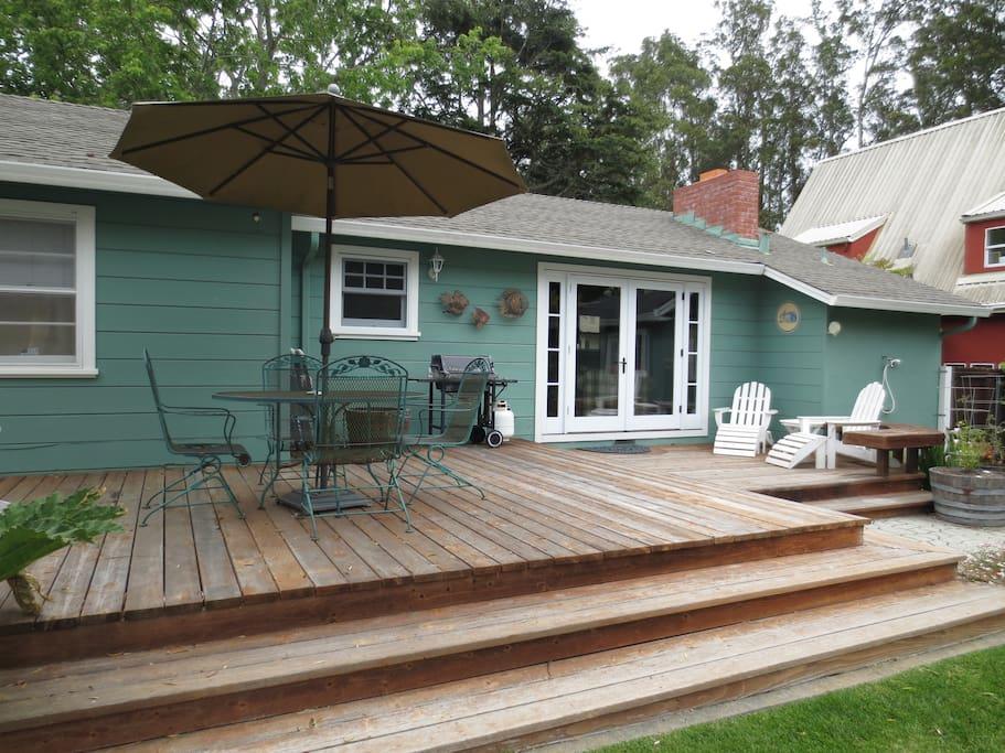 Expansive Backyard with Gas BBQ for Grilling, Outdoor Dining Set and Adirondack Chairs