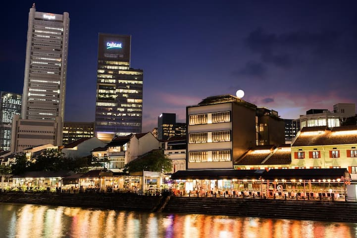 Our RiverView Heritage Apartments along Boat Quay in the Night