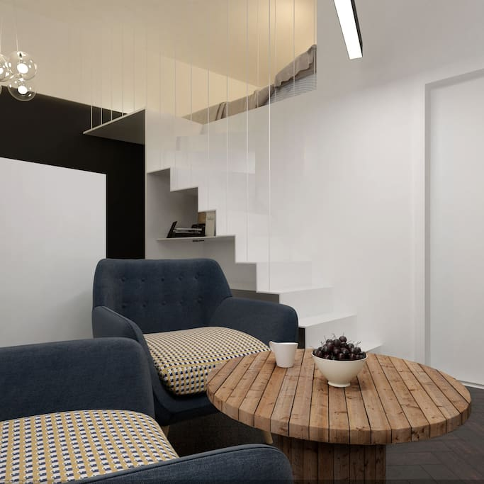 Living area and the stairs to the entresole ***Please note that pictures attached are visualisations as I am just finished a full refurbishment of the apartment***