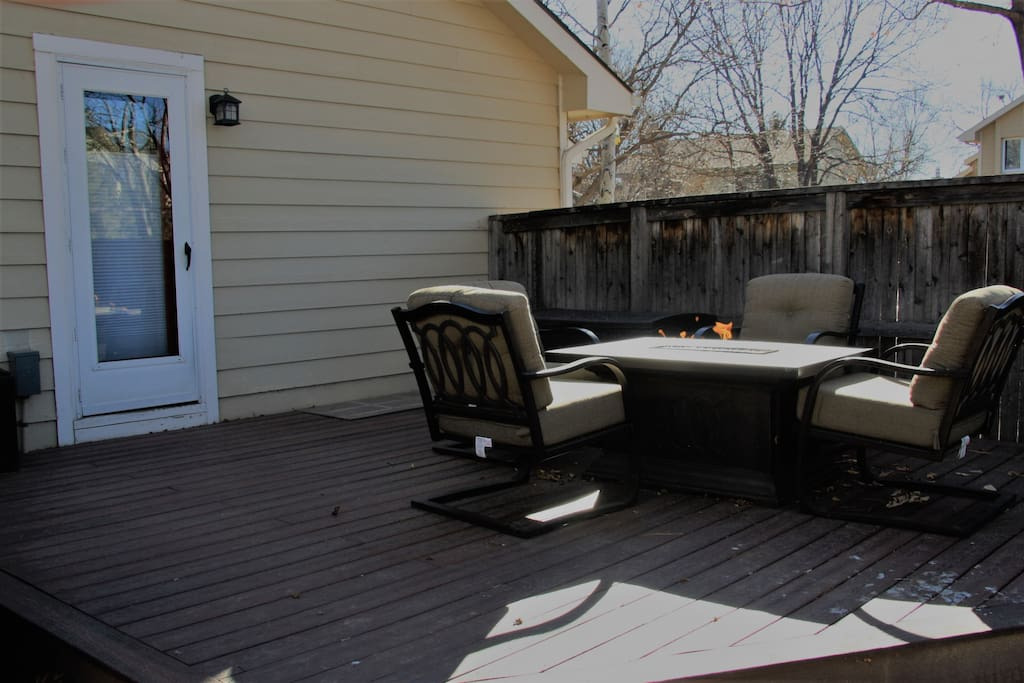 Great outside sitting area with a gas fire pit