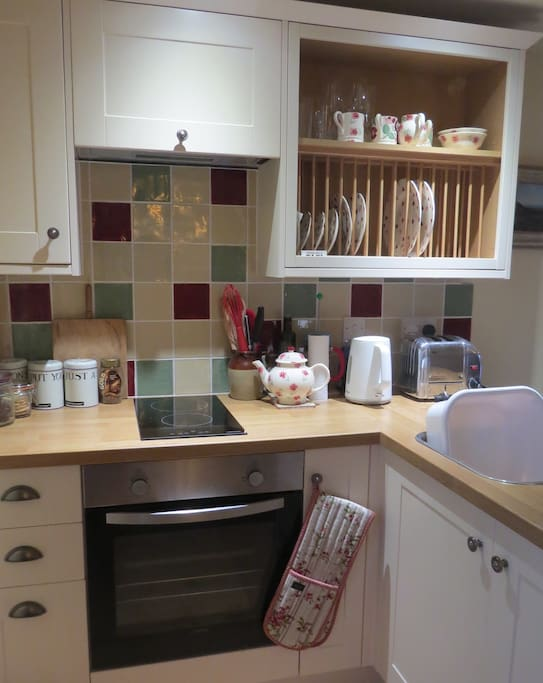The kitchen is small, but well equipped, and easy to work in, with top quality equipment
