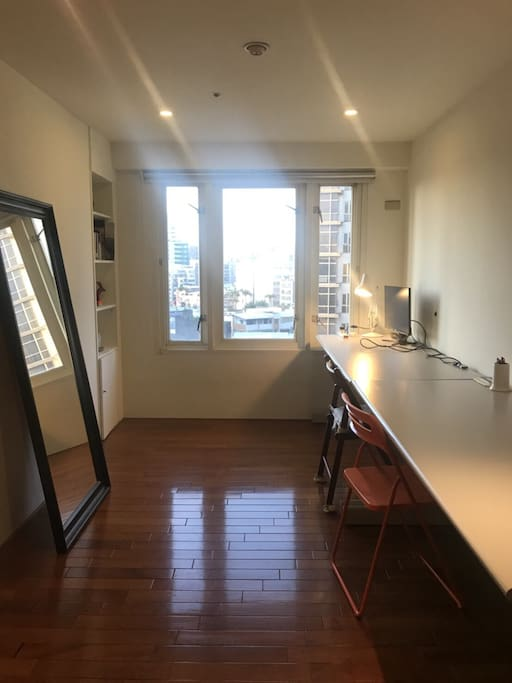 A bright study room with high speed internet - a separate space from the rest of the apartment to work remotely during holiday. There is a pc screen for connecting to your laptop.