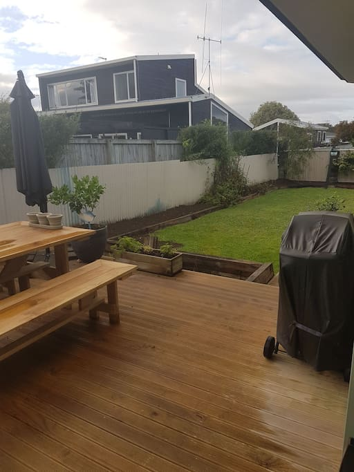 Quiet backyard with a deck and BBQ