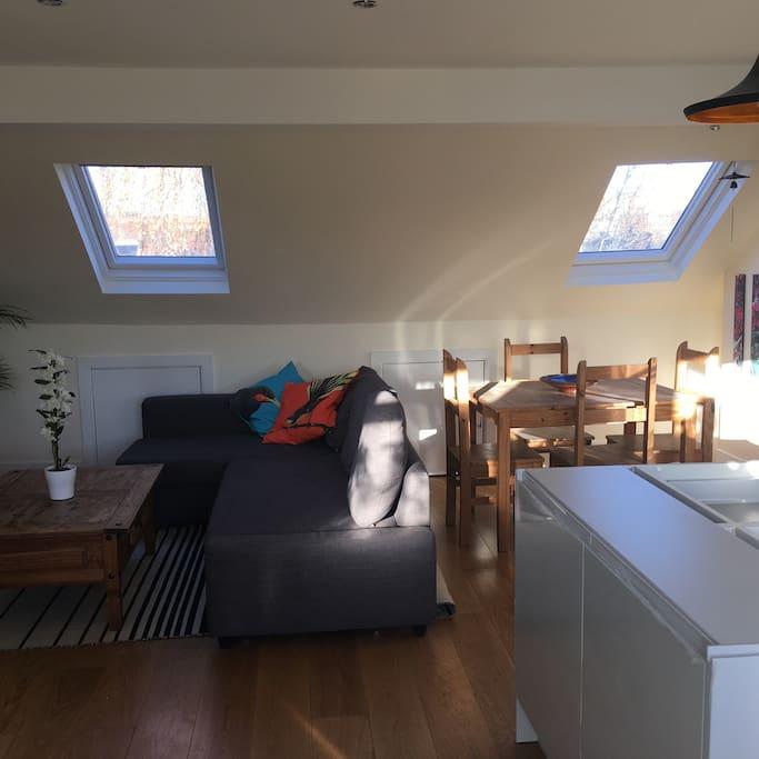 Open plan living room with brand new designer Italian kitchen