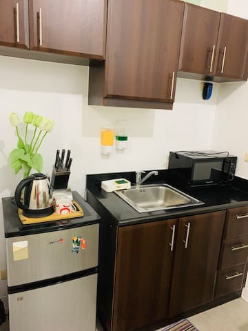 Knives, electric kettle, microwave oven and refrigerator.