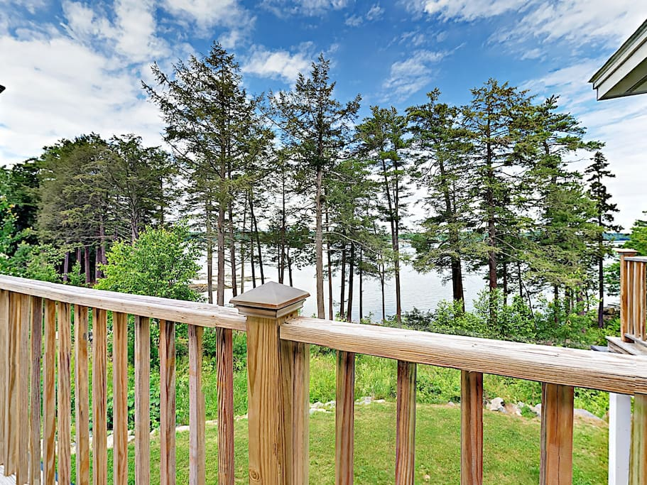 Begin each day with a hot cup of coffee on a shared balcony overlooking the Sheepscot River.