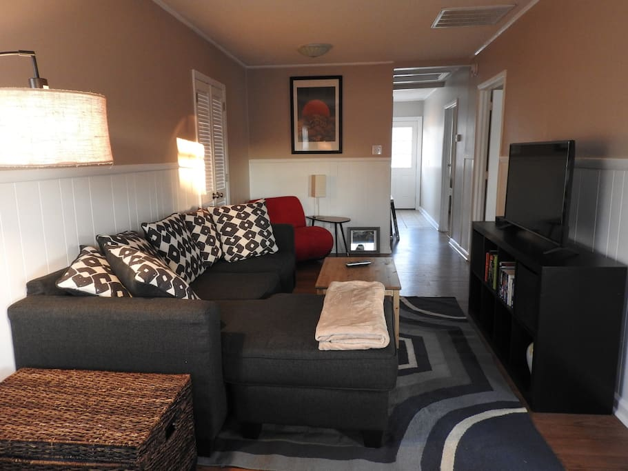 """Living area with 43"""" flat screen smart TV"""
