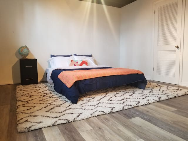 Third bedroom with queen bed and daybed and walk-in closet.