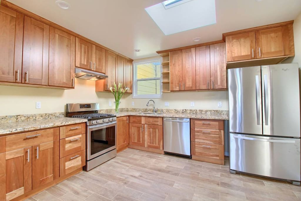 Chef's kitchen with gas stove, family size fridge and state of the art dishwasher.