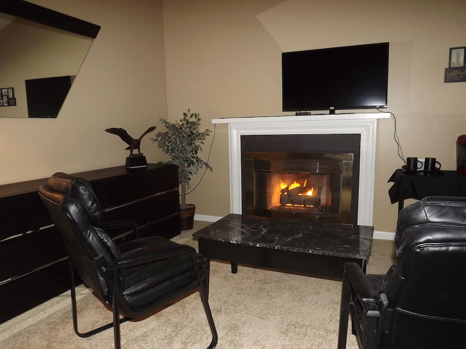 Cozy up in front of the gas fireplace and catch up on your favorite shows!
