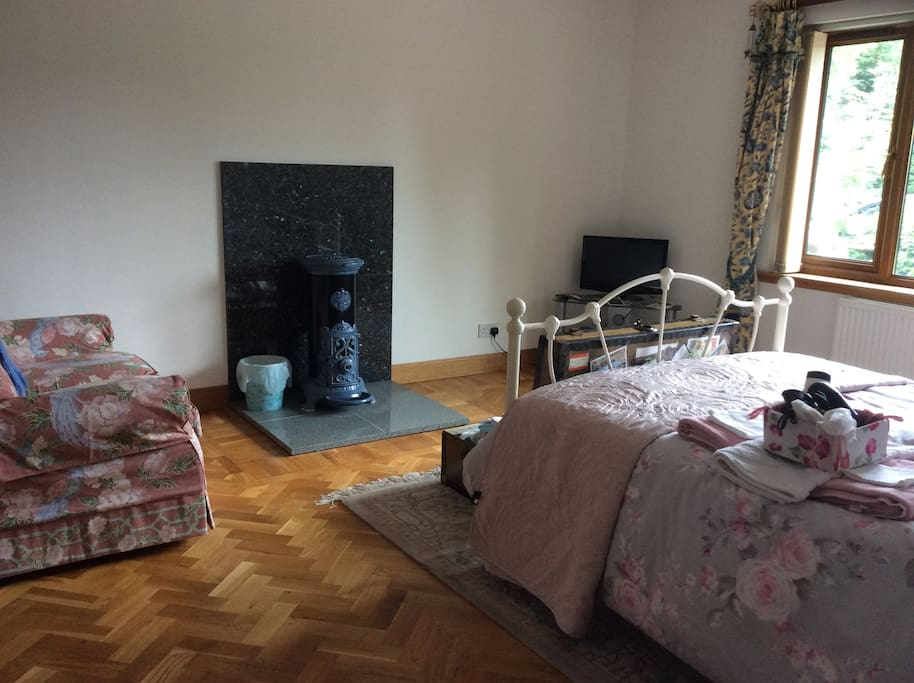 Large bedroom with private ensuite bathroom, double bed,Freeview t.v. and cozy sitting area