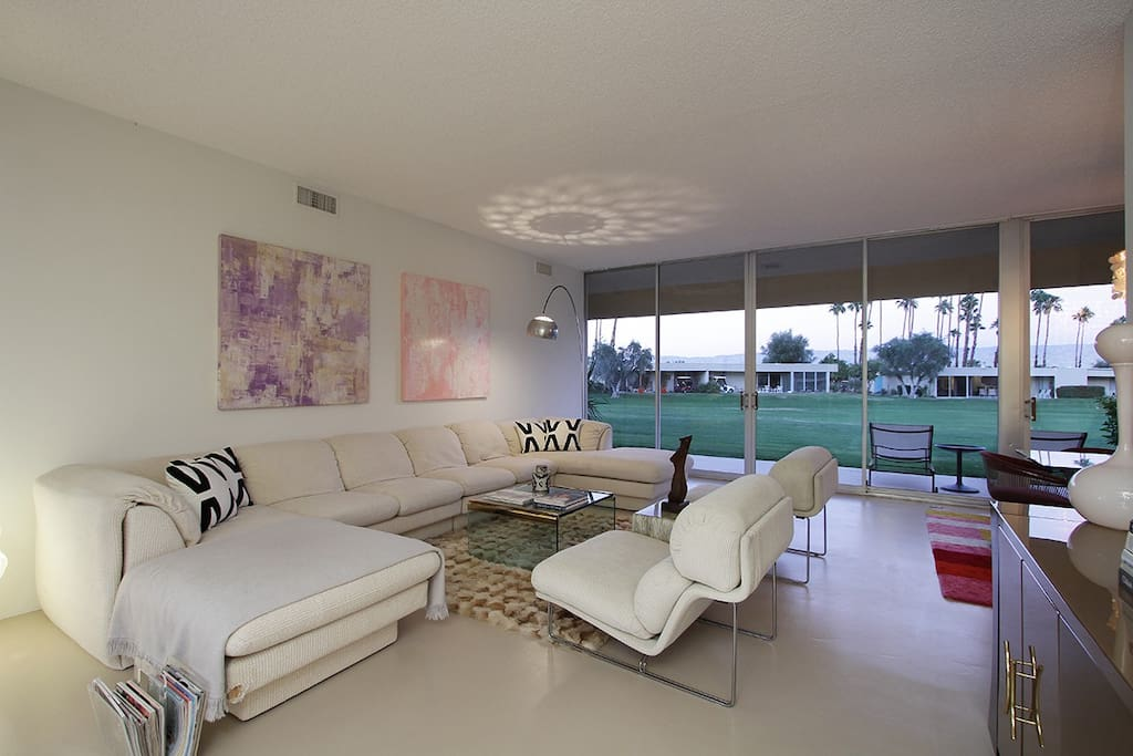 Living Room with all mid-century modern furnishings and view of golf course