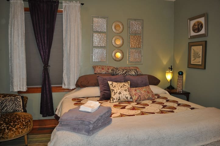 Comfortable king size bed with lots of pillows.