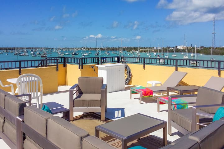 Waterfront condo with rooftop patio, balcony, and dock!