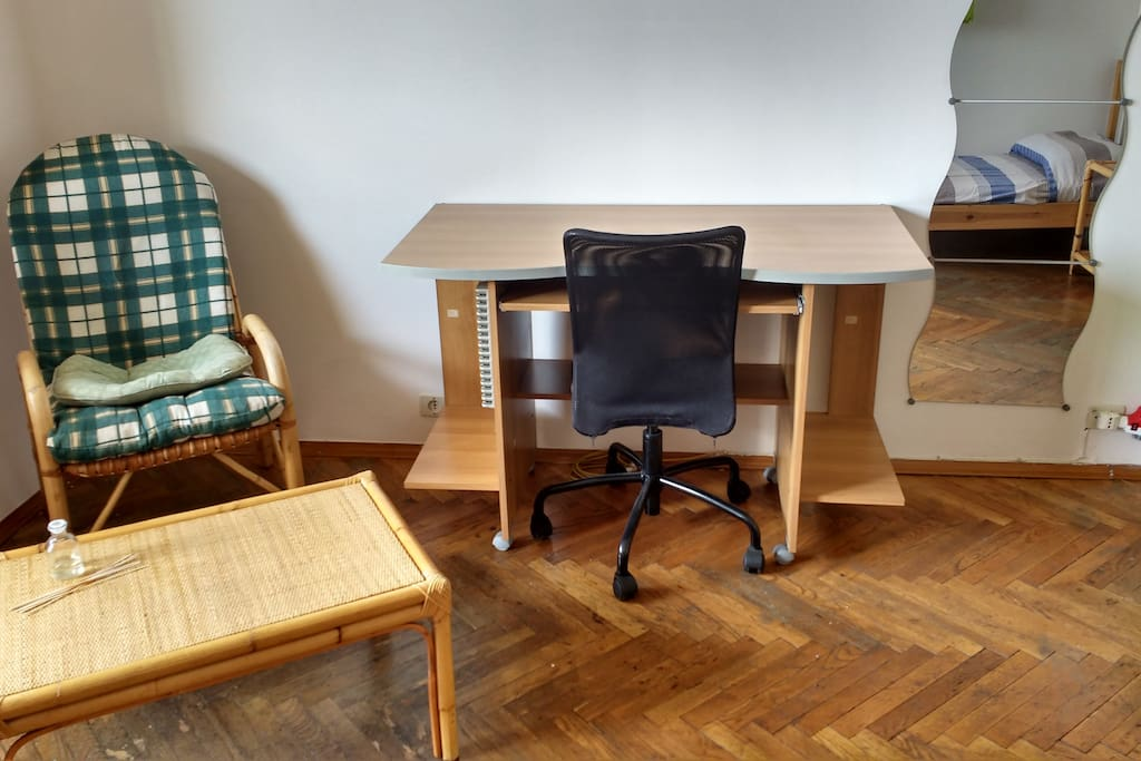 armchair and coffee table, desk with office chair, mirror