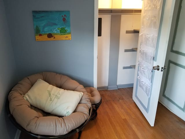 AirBnB Guest Br: Wolfpack Theme  Includes: Queen bed Smart TV Area Rug Nightstand Clock/Alarm clock Dresser/Cabinet Closet Mirror Coat rack (on bedroom door) Shoe rack (on closet door)