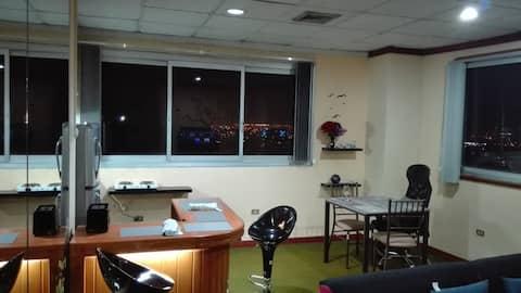 Suite céntrica con Inolvidable vista de la ciudad.