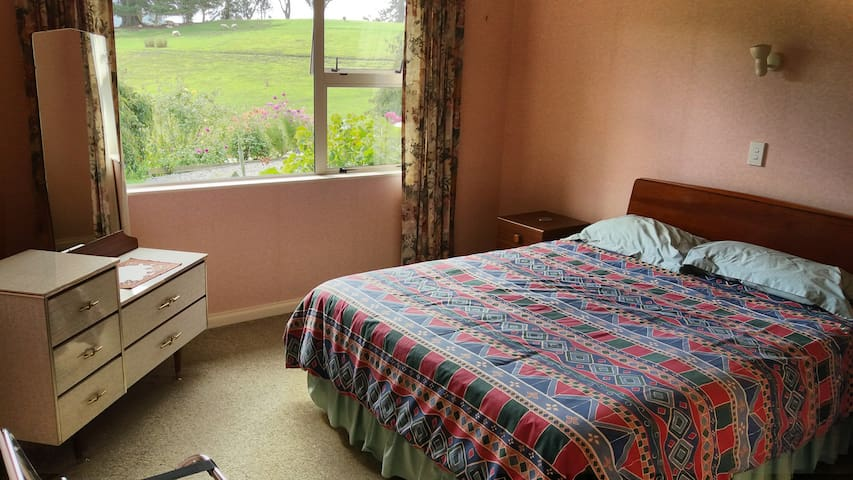 Queen size bed. Luggage rack. Lovely views across the gardens and farm.