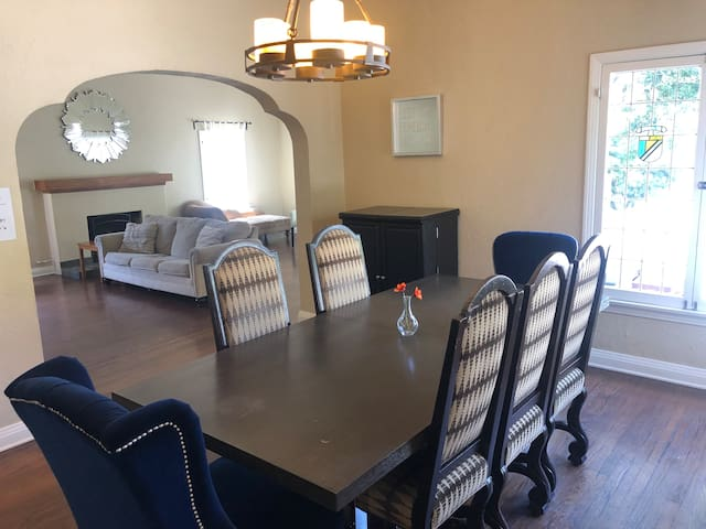 The Grand Exterior is matched by the Grand Interior. This Dining Room area flows and opens up to the huge Living Room area creating a Great Common Room area to enjoy with your friends and family.