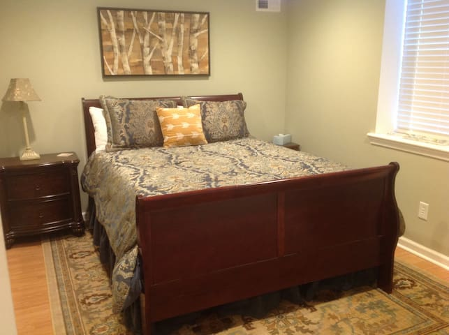 A comfy queen bed with walk in closet in the master bedroom.