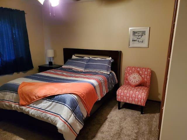 Queen bed in north bedroom