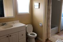 Bathroom with full tub and shower.  You will also find a linen closet and laundry.