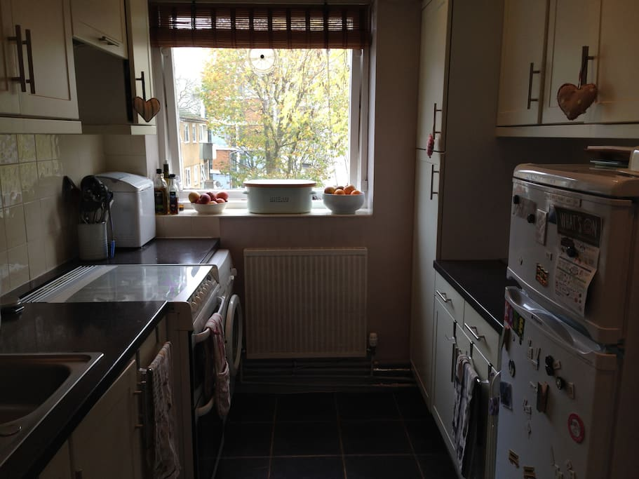 Gas cooker, washing machine, fridge freezer, toaster, kettle and all usual kitchen utensils