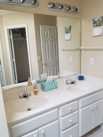 Master bath with dual vanity, walk in closet, garden tub and private toilet room.