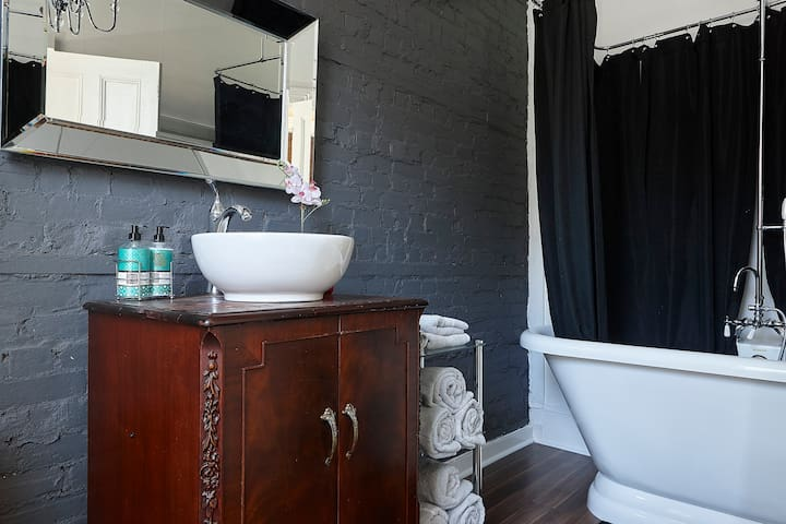Luxury washroom with soaker tub and shower.  Fluffy thick cotton towels and complimentary spa products.