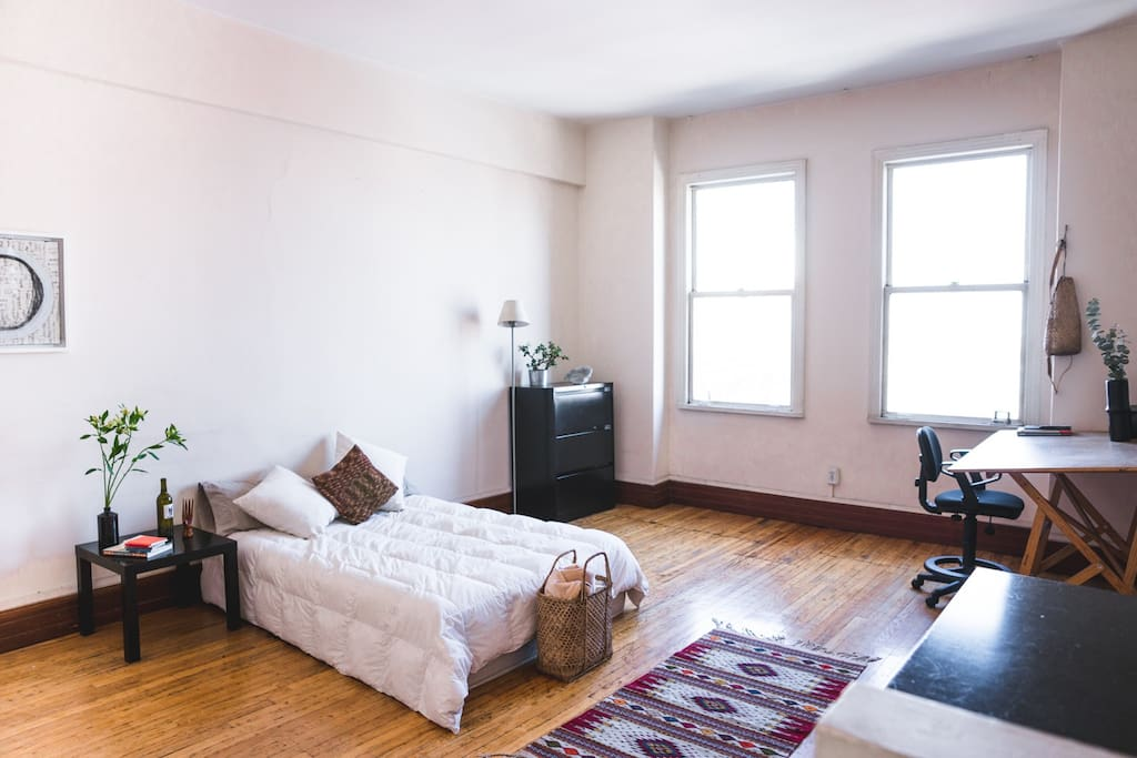 The room is wide open and is connected by the whole flat