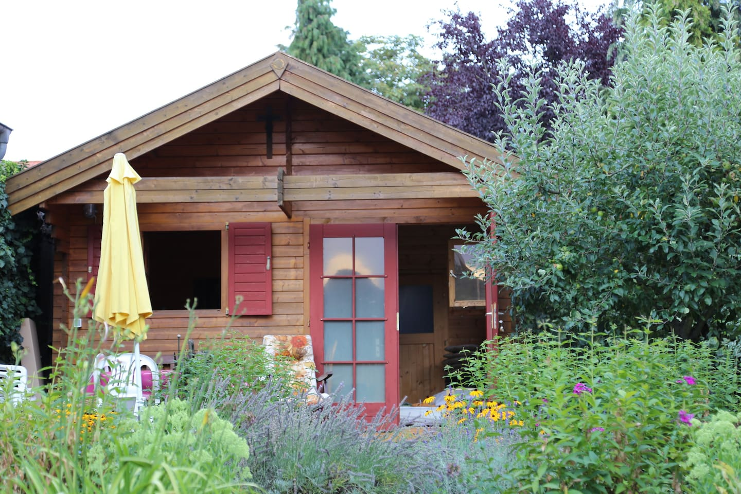 Beautiful wooden house in the middle of the garden!