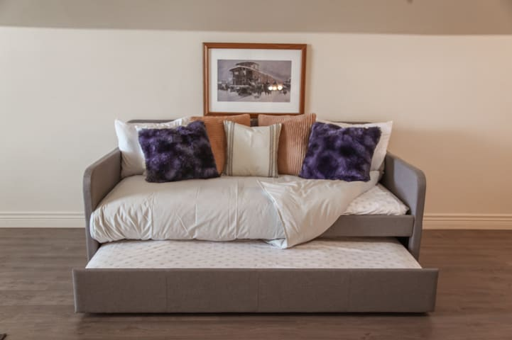 Trundle with 2 twin beds in the loft.