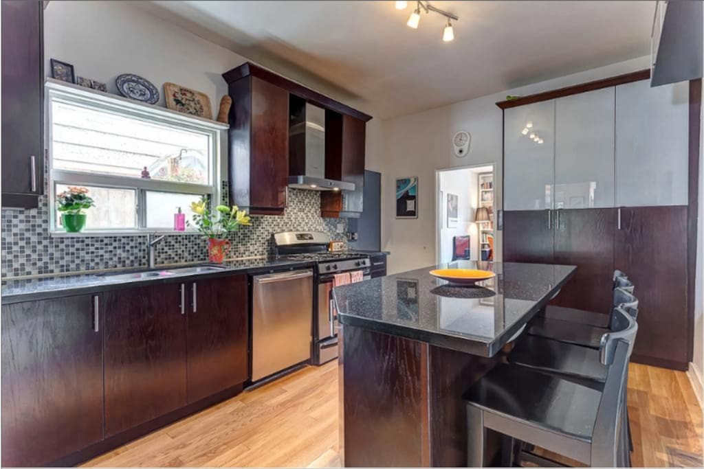 Kitchen has gas stove, dishwasher, microwave, fridge, large granite island.