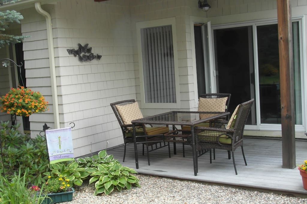 Beautiful outdoor seating on porch.