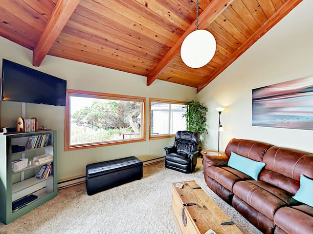 The living area offers a sofa, 2 armchairs, and a wood-burning fireplace.