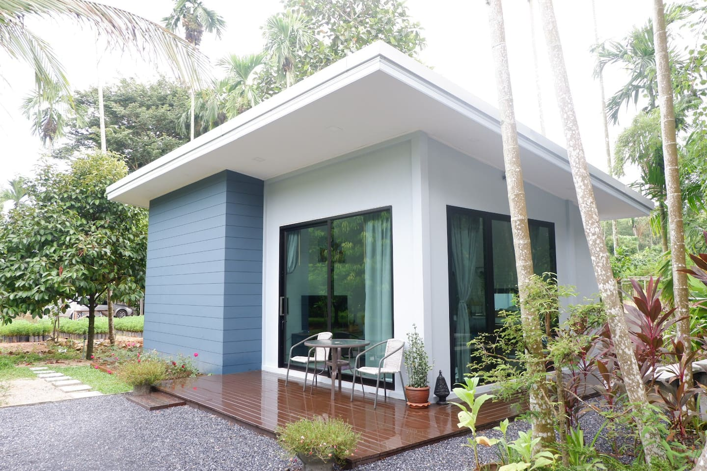 Homestay surrounded by green trees