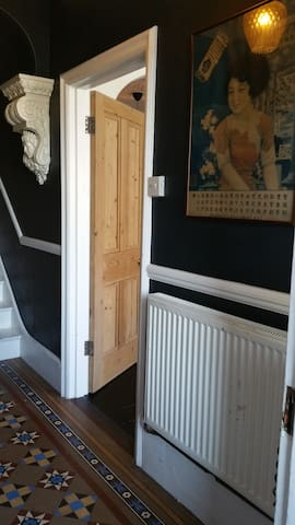 The doorway to the sitting room from the entrance hall