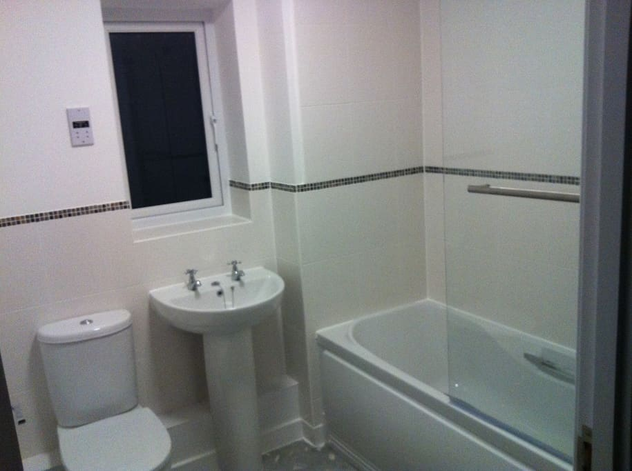 Shared bathroom - shower over the bath. Lock on door. There is also a toilet and basin downstairs as well.